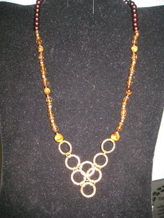 This Gold ringed necklace has Brown glass pearls with Tigers eye and Smoky Topaz Fire Polished stones in it $38.00 plus shipping