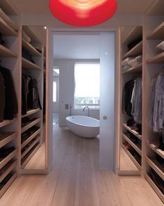 closet space onto gorgeous bathroom with Dinesen floor