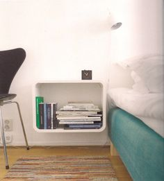 Bedside table, another space saver, very neat.