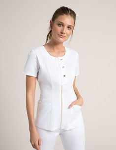 Snap Front Top in White is a contemporary addition to women's medical scrub outfits. Shop Jaanuu for scrubs, lab coats and other medical apparel. Scrubs Outfit, Scrubs Uniform, Beauty Uniforms, Medical Uniforms, Uniform Design, Womens Scrubs, Medical Scrubs, Nursing Schools, Blouse