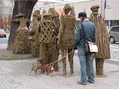 Gathering branches surrounding a tree, artists Agnieszka Gradzik and Wiktor Szostalo use the organic material to create wicker-people that embrace the tree. That's right, these figures are literally, tree huggers. Rather than something out of a sixties, however,