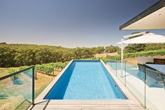 Aloha Pools Pty Ltd designed this formal pool in Main Ridge, Victoria, Australia. Striking out towards the vineyard, this lap pool is a striking blue highlight amongst the vibrant green and sun-bleached yellow of the surrounding rural property.