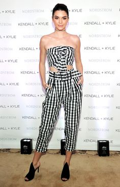 KENDALL JENNER in a gingham crop top and pants with open-toe sandals, all from the Kendall + Kylie collection, at a Nordstrom luncheon celebrating the line in L.A.