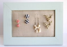 best way to display jewellery.     All thats needed:  -needle art canvas(1.00)  -wooden fram (1.50)   SO cheap.