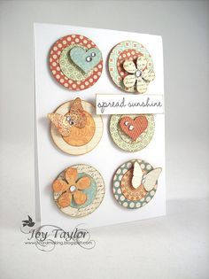 Love the simple combination of punched circles, hearts, flowers, and other small items.  Very nice indeed1