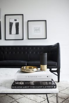 Gorgeous black and white living room // black couch / white coffee table / art above sofa