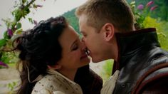 Prince Charming (Josh Dallas) and Snow White (Giniffer Goodwin) kissing for a Once Upon A Time episode