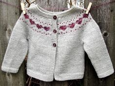 Little Hearts is a simple baby cardigan that features a sweet colorwork heart yoke detail - find the pattern on LoveKnitting!