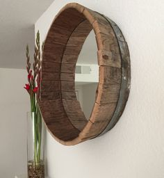 This mirror is 22-24 wide and fits perfectly into a piece of an authentic wine barrel. Youll see the stains of wine that was previously held in the barrel. This is a beautiful and unique piece of décor for your home to reflect your love for wine and art. Width 22-24 Depth 3-5