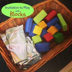 Invitation to play with wooden blocks and tin foil. Simple play idea for hours of fun.