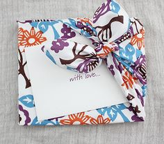"Gift wrapping with fabric -- corner tie wrap with a downloadable ""how to"" posted on Once Upon a Fold"