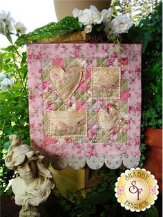 """This delightful pattern is a part of The Rivendale Collection by Sally Giblin. Pattern includes instructions for stitchery and instructions for the wallhanging. Finished size is 20"""" x 16""""."""