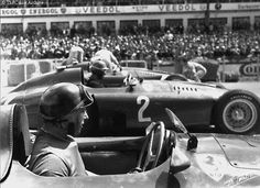 Juan Manuel Fangio in his Ferrari D50 just before the start of the German Grand Prix 1956.