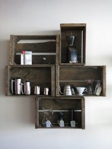 Very clever arrangement of old crates.  Draw round the crates onto sheets of paper, rearrange until happy. Tape in place, mark the holes & drill, use the same paper as a template for holes in the crates!