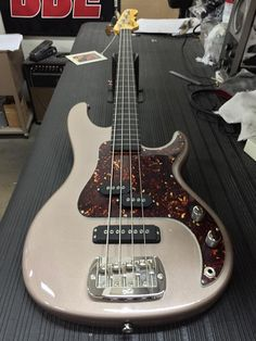 G&L Musical Instruments added 3 new photos. Here's an SB-2 in Shoreline Gold, tortoise guard, ebony fretless board with white inlaid ghost lines, Vintage Tint Gloss neck finish.