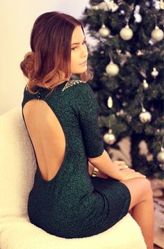 You should definitely wear the most glamorous and festive version of the dark green dress. If it is sequin and backless, it's the perfect garment for Christmas events. Keep it simple with pointy black heels and a golden bracelet.