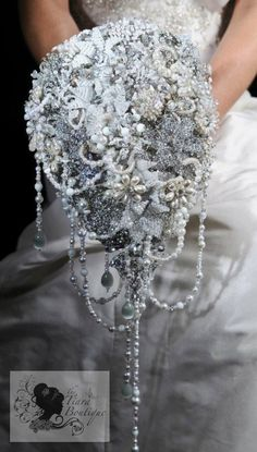 Beaded flower and brooch bridal bouquet. OMG