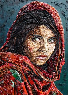 'Afghan Girl' portrait made from recycled beads and plastic bits.