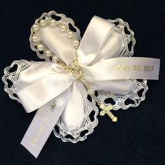 These personalized Baptism or First Holy Communion favors are decorated with a silver rosary Communion Favors, Baptism Favors, Pink Jordans, Almond Flower, Jordan Almonds, Candy Flowers, Personalized Ribbon, Greek Wedding, First Holy Communion