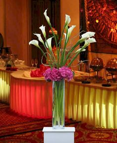 Tall Calla Lily in clear glass cylinder vase with Hydrangea flowers