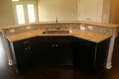 "Custom kitchen island from the ""Brotka"" house plan. #michaelrobertsconstruction #kitchenisland http://robertscc.com/brotka/"