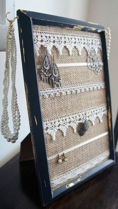 An old picture frame can be reused as a jewelry organizer that can be envisioned to match a rustic, cozy theme and the use of burlap and dollies could certainly help. Z