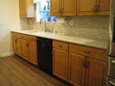 Finally finished my kitchen remodel! I used our existing oak cabinets and replaced the formica counter with quartz; installed a glass mosaic backsplash; replaced fixtures & cabinet pulls; replaced linoleum floor with luxury vinyl tile; and the walls received a fresh coat of paint.
