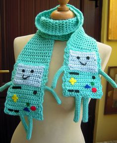 Super cute crocheted Beemo from Adventure Time scarf. Beemo has felt and wool features and crocheted arms and legs. Total length of scarf is