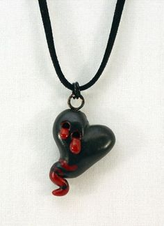 Vampire Heart polymer clay heart pendant necklace by Tamara Dozier. Available on Etsy, $25.00 https://www.etsy.com/listing/52869237/vampire-heart-polymer-clay-heart-pendant?ref=shop_home_active