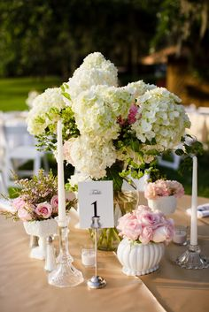 Beautiful Milk glass centerpieces of Hydrangea and roses