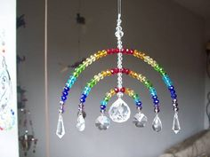 """Sun Catcher by Shaggy Ink Cap plus shipping Buy at Etsy Made in Sandhurst """"A beautiful Rainbow Sun Catcher, made fro. Wire Crafts, Bead Crafts, Mobiles, Diy Dream Catcher Tutorial, Stained Glass Birds, Fused Glass, Dream Catcher Craft, Diy Wind Chimes, Wind Spinners"""