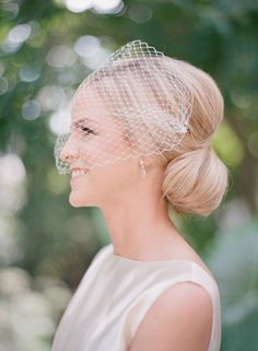 20 Ways to Wear a Veil With Your Wedding Hairstyle - Whether you're sporting a formal updo or long, loose waves, here's the lowdown on wedding hairstyles with veils. white birdcage  {Audra Wrisley Photography}