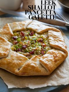 """Leek, Shallot, and Pancetta Galette. Penny-pincher tip:  swap bacon for pancetta, and instead of gruyere, give a flavor """"facelift"""" to a cheaper Swiss cheese by grating and soaking in a tbsp or two of white wine."""