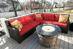 Home of the Week: Jill Johnson   The deck features an L-shaped black lacquered wicker couch, plumped with scarlet cushions, is nestled around a round stone gas fire pit filled with glass beads.