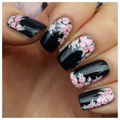 Black Nails with Pink Flowers Nail Art.