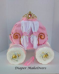 This beautiful Princess Carriage Diaper Cake is perfect for your little princess. Includes: 75 size one diapers, 1 receiving blanket, 3