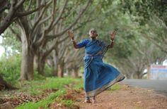 """An amazing pic of Saalumarada Thimmakka and 384 Ficus trees, which she helped plant along the Hulikal-Kadur Highway."""