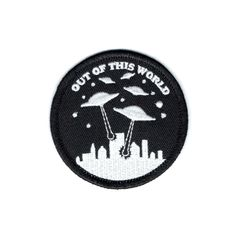 We come in peace.  2.5 iron on patch with merrowed edge.