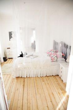 White bedding, wooden floors