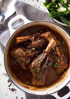 Port Braised Lamb Shanks - easy to make slow cooked lamb shanks in an incredible port wine sauce! Slow Cooked Lamb Shanks, Braised Lamb Shanks, Lamb Recipes, Meat Recipes, Cooking Recipes, Cooking Tips, Dinner Recipes, Slow Cooked Meals, Slow Cooker Recipes