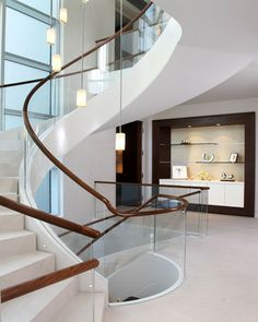 Spiraling staircase in glass with wood banister. different and gorg! Freestanding Staircase - modern - staircase - san diego - Arcways, Inc.
