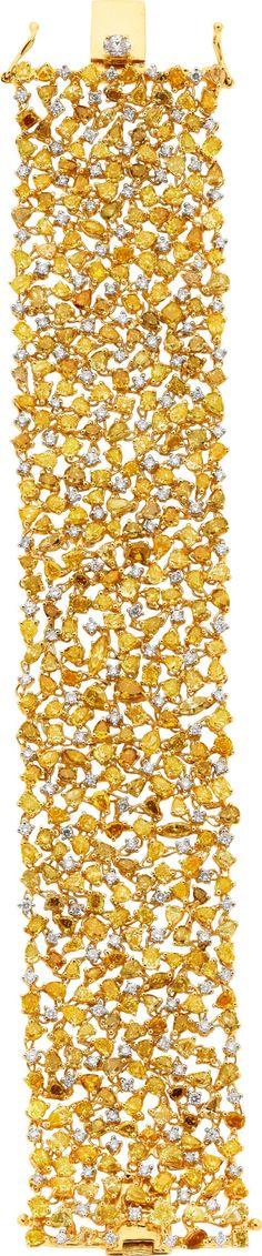 Fancy Yellow Diamond and Gold Bracelet.