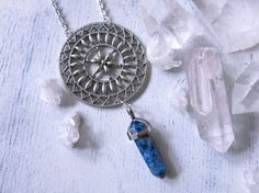 The Divinity necklace features a beautiful mandala design in tibetan silver & sodalite drop point.  Sodalite stone has a strong vibration that