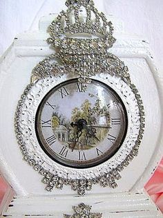 Rhinestone clock - Something similar could be quilled in place of the jewels, with quilling in a little scene under the glass, also.