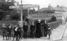 The Cannon or Cross Rifles Junction. Notice the cannon above the children's heads and Popham's Cross Rifles Pub building behind.  This Pub, was the location of the dinner given by the contractors, for 200 navies in a tent at the rear on the day of the opening ceremony.                                                                               Authors collection. C1894 Unknown photographer.