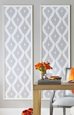 Showcase fun wallpaper patterns by framing strips in decorative moulding.