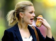 Drew Barrymore with a hot dog