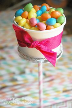The colours of the sweets inside the cup is very colourful and summery.