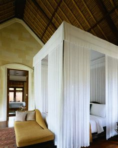 love these canopy beds. definitely want one, maybe not so much curtains because of joey ha. but what i say goes :)
