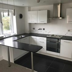 Installed We installed the Urban Quartz Nero De Lusso to this compact high gloss white kitchen in Bishops Stortford. Beach House Kitchens, Home Kitchens, High Gloss White Kitchen, Granite, Kitchen Design, Sweet Home, Kitchen Cabinets, Home Decor, Black
